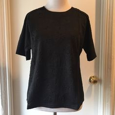 Paisley floral texture black dressy t shirt Black short sleeve tee shirt blouse. Features great textured floral and paisley pattern. Bit boxy and cropped in fit. Great details and unique! Brand is Rehab, sold on Nasty Gal.  *Available in small, medium, large. Nasty Gal Tops Blouses
