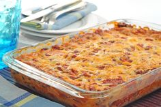 Mexican Casserole: layers of ground beef flavored with taco seasoning, tortillas, green chiles & cheese with enchilada sauce. Faster & easier than individual enchiladas! #Recipe