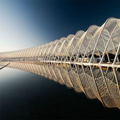 Santiago Calatrava - architect and structural engineer. Here is some high class functional, 3D, repetitive work. what is nice about this is that the water reflects the bridge, emphasizing the repetition.