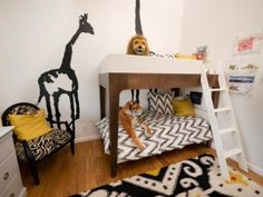 African-inspired and animal prints are paired with wild life wall decals and stuffed animals to create a safari theme in this shared kids' room.