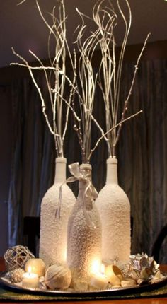 Innovative DIY Wine Bottle Crafts You Must Try Pure White Centerpieces for Christmas Wine Bottle Centerpieces, Wedding Wine Bottles, Diy Centerpieces, Christmas Centerpieces, Christmas Decorations, Glitter Wine Bottles, Wedding Decorations, Paint Wine Bottles, Wine Bottle Decorations