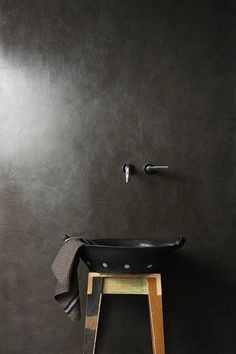 via vosgesparis: I found this picture on Remodelista and just loved the dark and simple feel of it.... it is an advert from South Africa-based paint brand Earthcote, ain't that a beautiful wall?!