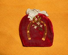 "Edwardian Atq Needle case Velvet, Silk & Wool. Handmade Hand embroidered Beauty | eBay; late 1800s/early 1900's; padded velvet with silk backing, inside 3 pages of kidskin leather embroidered around the edges in baby blue thread; top has blue silk bow and small loop so that it can be hung; 3 inches high and 2-3/4"" across"