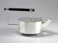 """Christopher Dresser (British, 1834-1904)/ Alessi (Italy)  """"Teapot"""" designed 1880 silver-plated brass, wood  6.5 x 12 x 6.5"""" Limited reproduction of the original by James Dixon & Sons, England. Photo: Kevin O'Dwyer"""