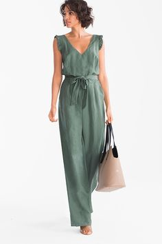 This jumpsuit with frilled straps and tie belt brings a feminine stylish note to an outfit Mode Abaya, Outfit Trends, Jumpsuit Dress, Summer Jumpsuit, Strapless Jumpsuit, Linen Dresses, Jumpsuits For Women, Rompers Women, Casual Looks