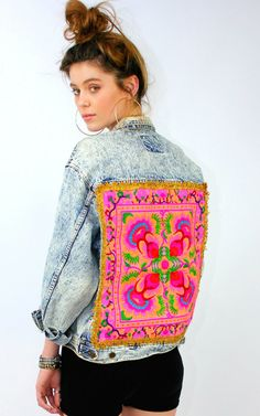 Join our gang in our vintage stonewashed denim jacket featuring a beautifully intricate pink embroidered panel with ornate gold border trim.