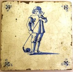 glazed clay Dutch tile depicting one of a series of games in blue and white, a boy playing hockey with spider design in corners, 17th century