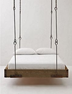Anthropologie/Hanging Wood Bed. Great idea for a cabin!!! Twin beds would be ideal!