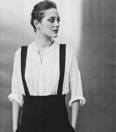 Cotillard.  I want to take a series of portraits like this. dark makeup, slicked back hair, contrasting clothing, etc.