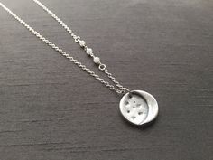 "Crescent Moon Pendant; handcrafted in fine silver (.999%), this hangs at 17""on a sterling silver chain and has 3 dainty moonstone wired wrapped onto one side. Perfect for the moon lovers! ($42) #moonpendant #moonjewelry #silverjewelry"