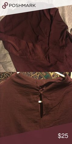 Mock turtleneck burgundy blouse Such a cute top from H&M. I've only worn it once because the sleeves were just slightly too tight. Looks great paired with anything. Has cute little buttons on the back of the neck. Make me an offer! (The cover picture shoes how the top fits. Full length sleeves) H&M Tops Blouses