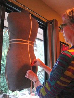 Making a duct tape dressmaker's dummy – the right way.  These instructions are clear, many pictures, and the resulting dress form looks really professional