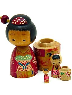 Japanese nesting dolls typically consist of a set of dolls of increasing sizes placed one inside the other.1950