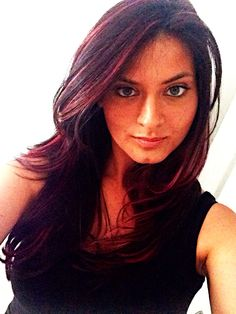 Dark brown hair with pink/bright red highlights