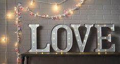 All you need is (this) LOVE (marquee sign)! and globe lights . and colorful string lights for a festive display!