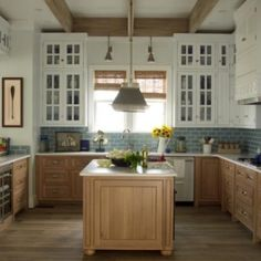 Oak or hickory bottom and white above with darker oak floors. Robbie Hickman and Tria Giovan