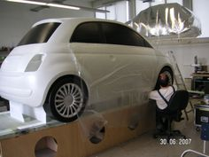 Spray paining the radio controlled flying Fiat 500 life sized model.