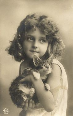 Edwardian Girl with cat photo card.  Girl in photo is in many other photos.