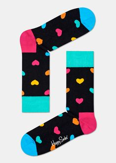 Spread the love! Hearts in shades of pink, green, blue, orange and yellow make these black heart socks irresistibly fun and expressive. Knited from high-quality combed cotton for superior comfort, this pair of socks gives feet a squeeze of love every time they're worn. Offered in sizes for women and men.
