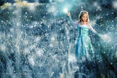 My daughter decided to dress up in her Frozen gear and asked to do a photo shoot ( a rare occurance ) so we went to a local field and took a few shots.  The shot was taken in FL where it never snows...so I decided to freeze it up in post.