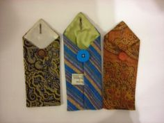 Great use for old ties, little button-close bags for anything... change, phones, snacks.