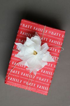 crepe paper poinsettia gift topper...found on #julep   also, that awesome personalized wrapping paper?  can be purchased from #minted