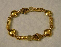 Gold Metal Crystal and Hamsa Beadframe Stretch by EEEMAsBeads