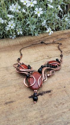 Hey, I found this really awesome Etsy listing at https://www.etsy.com/listing/264254354/tangled-copper-wire-wrapped-necklace