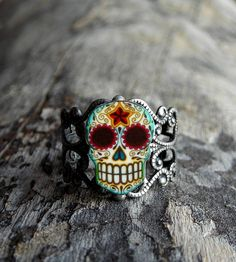 Day of the Dead Filigree Sugar Skull Ring ( Etsy:: http://www.etsy.com/listing/88065071/day-of-the-dead-filigree-sugar-skull# )