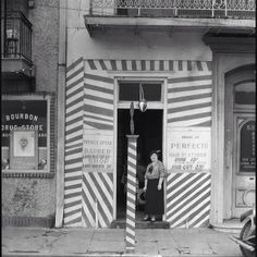 """Painted Doorway of """"French Opera"""" Barber Shop on Bourbon Street, New Orleans, Louisiana, February–March 1935. © Walker Evans Archive"""