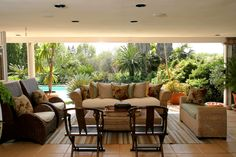 The gorgeous garden in the back makes this living room look like an island paradise
