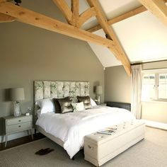 Beige and wood-beamed bedroom. An open ceiling and reclaimed beams makes this bedroom feel bright and spacious. An upholstered floral headboard adds a touch of luxury. Olive Green Bedrooms, Cream Bedrooms, Bedroom Green, White Bedroom, Bedroom Colors, Master Bedroom, Bedroom Decor, Bedroom Ideas, Bedroom Chest