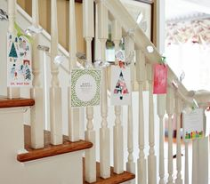 Stairs with garland and holiday cards. A beautiful and simple way to display your Christmas cards.