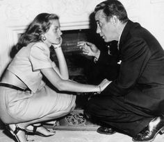 Lauren Bacall and Humphrey Bogart. I love the way she is looking at him.