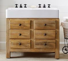 Mason Reclaimed Wood Double Sink Console - Wax Pine finish #potterybarn--Perfect for a small bathroom too...love the rustic wood and thinking two mirrors mounted to an old gate would look killer