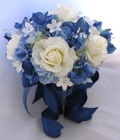 for MOH and brides maids I will change the white flowers to silver. ????