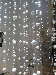 Cottonball snow for Christmas - use thread and needle for hanging. The children would love this in their room or playroom