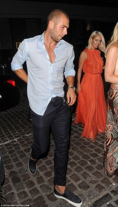 Partying with the pals: The 23-year-old footballer was spotted out having fun with Nicole's friend Caroline Stanbury (right), who had been on the Mykonos holiday with the former Pussycat Doll -- Look at this gorgeous man's outfit, what's missing? I  REALLY Really Really hope he's wearing no show socks with that shoes!