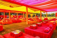 bright pink decor, pink and yellow decor for mehendi , outdoor mehendi decor, seating on gaddas, tenting