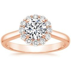 The subtle floral diamond halo blooms around the center gem in this exquisite ring (average 0.35 total carat weight). Available in 14K Rose Gold..