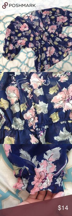F21 Sheer Floral Top Beautiful sheer top from Forever 21. Size small. Navy background with pastel floral design in peach, yellow, purple, cream, and grey. Stretchy elasticized band that allows fabric to flare out at waist with button detailing along front (photo 2). Elasticized bottom of sleeves as shown in photo 3. Very good condition with no visible signs of wear. Forever 21 Tops Blouses
