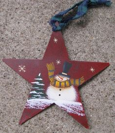 "g1642060R - Metal Red Snowman Star 5 3/4"" Metal Star $ 3.95"