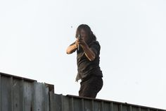 Norman Reedus as Daryl Dixon shooting at Negan's Saviors who are now joined with the Scavengers.- The Walking Dead Season 7 Finale, Episode 16 'The First Day of the Rest of Your Life' - Photo Credit: Gene Page/AMC
