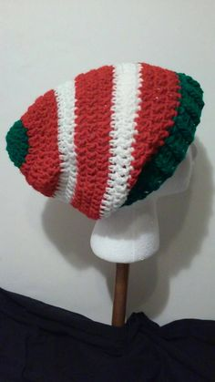 Check out this item in my Etsy shop https://www.etsy.com/listing/261882065/crochet-hat-red-white-and-green-striped
