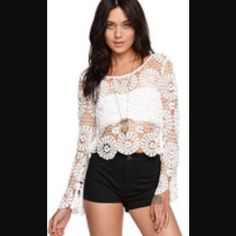 Kendall and Kylie White Lace Long Sleeve Crop Top Gorgeous white lace top from Kendall and Kylie Collection. Button closure in the back Kendall & Kylie Tops
