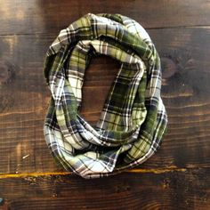 Part of our Southern Songbook Collection, this  infinity scarf is crafted from reclaimed Woolrich forest green + white plaid flannel. Whether you find yourself home on the range or in the city, your cozy flannel scarf will keep out the cold.  Limited run of 15 pieces.  One size.  Handcrafted in Nashville, TN