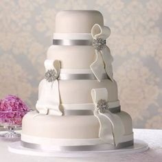 Brilliant idea. Save money by using a grocery store make the wedding cake . Not just sheet cakes people! Check this out!
