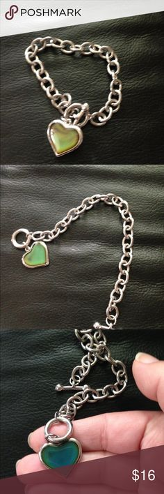 Woman's bracelet Really nice stainless steel heart bracelet with a heart that is a mood heart! It changes colors depending on your mood! Has barbell closure clasp on it Jewelry Bracelets