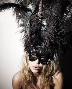 black mask with tall black and peacock feathers