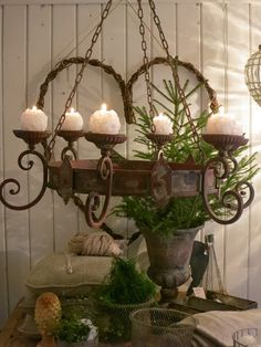 An old Chandelier with candles bring new life to it.